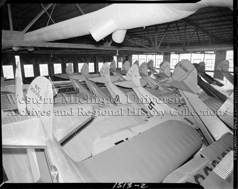 Western Michigan Flying Service, pilot training airplanes inside hangar