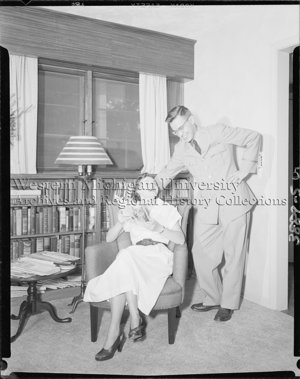 Domestic interior, man and wife at home