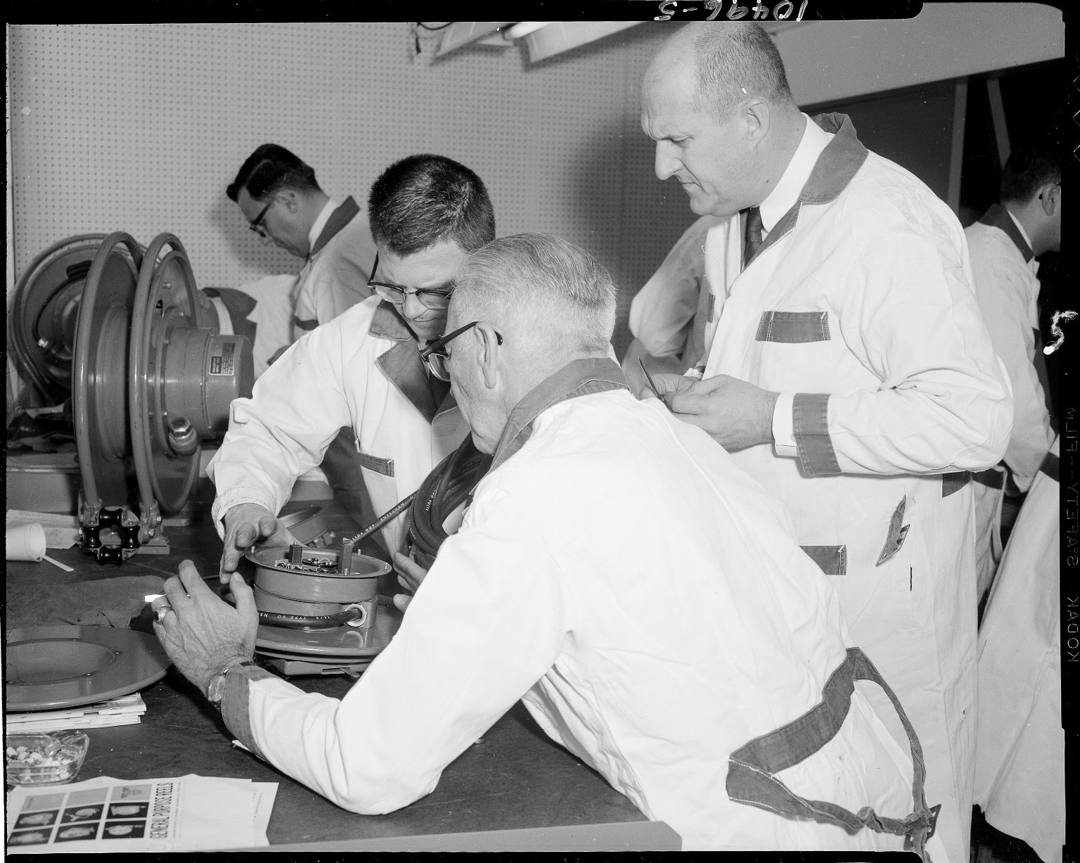 Aero-Motive Manufacturing Company, men working on reel at Sales Representative School