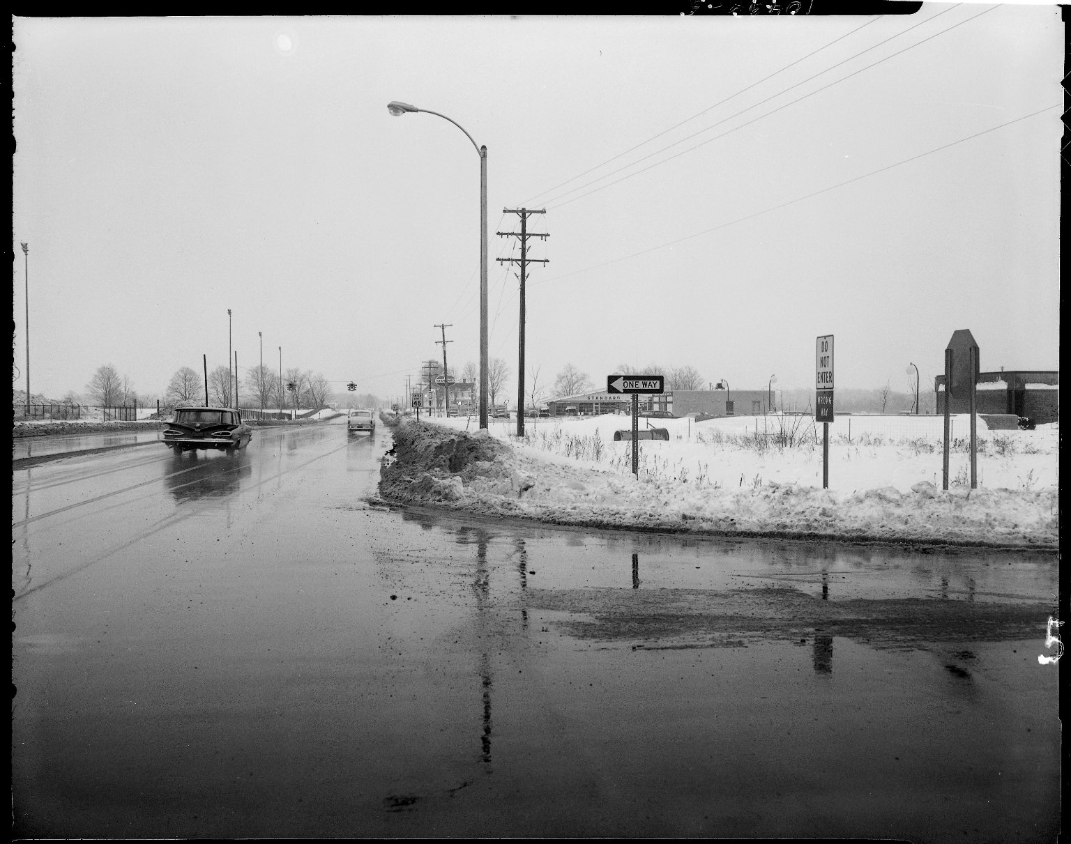 Winter street scene, Sprinkle Road, near I-94 entrance ramp, near Dick Kuehl Standard Service, 3530 Spring Road, Kalamazoo