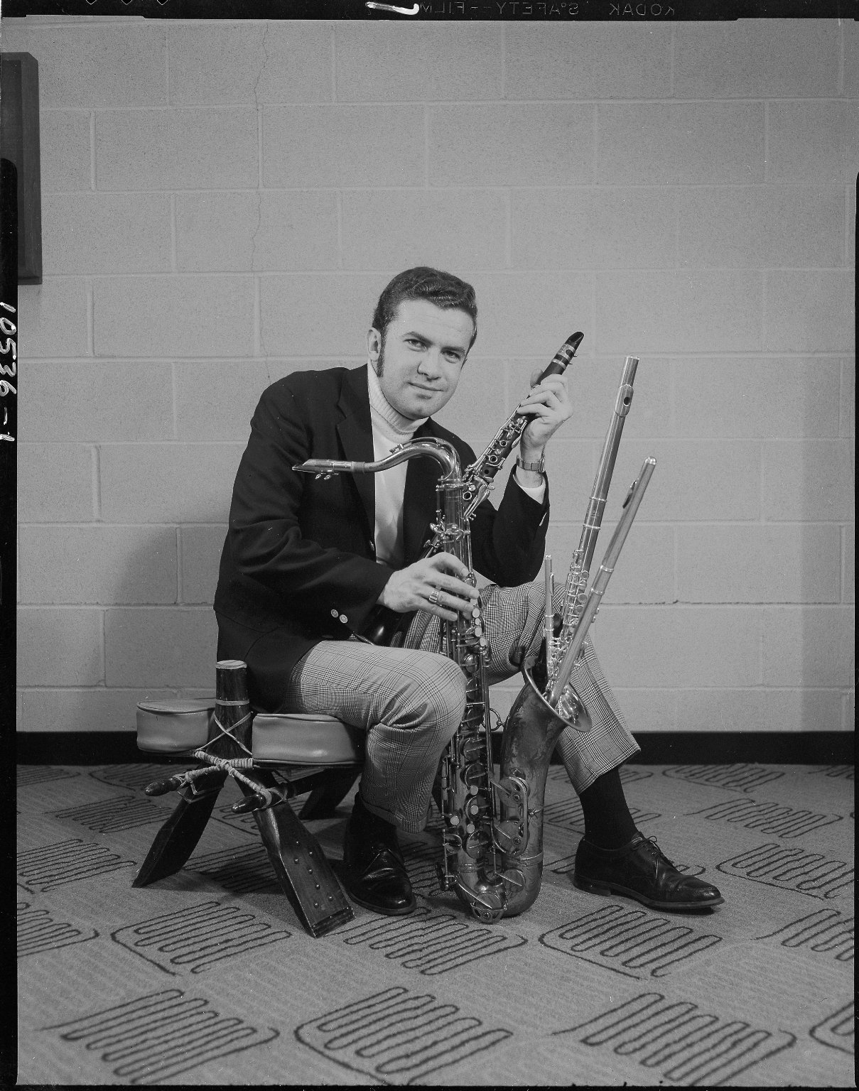 Don Neal's Mr. T-Bone, man posing with musical instruments, nightclub promotion