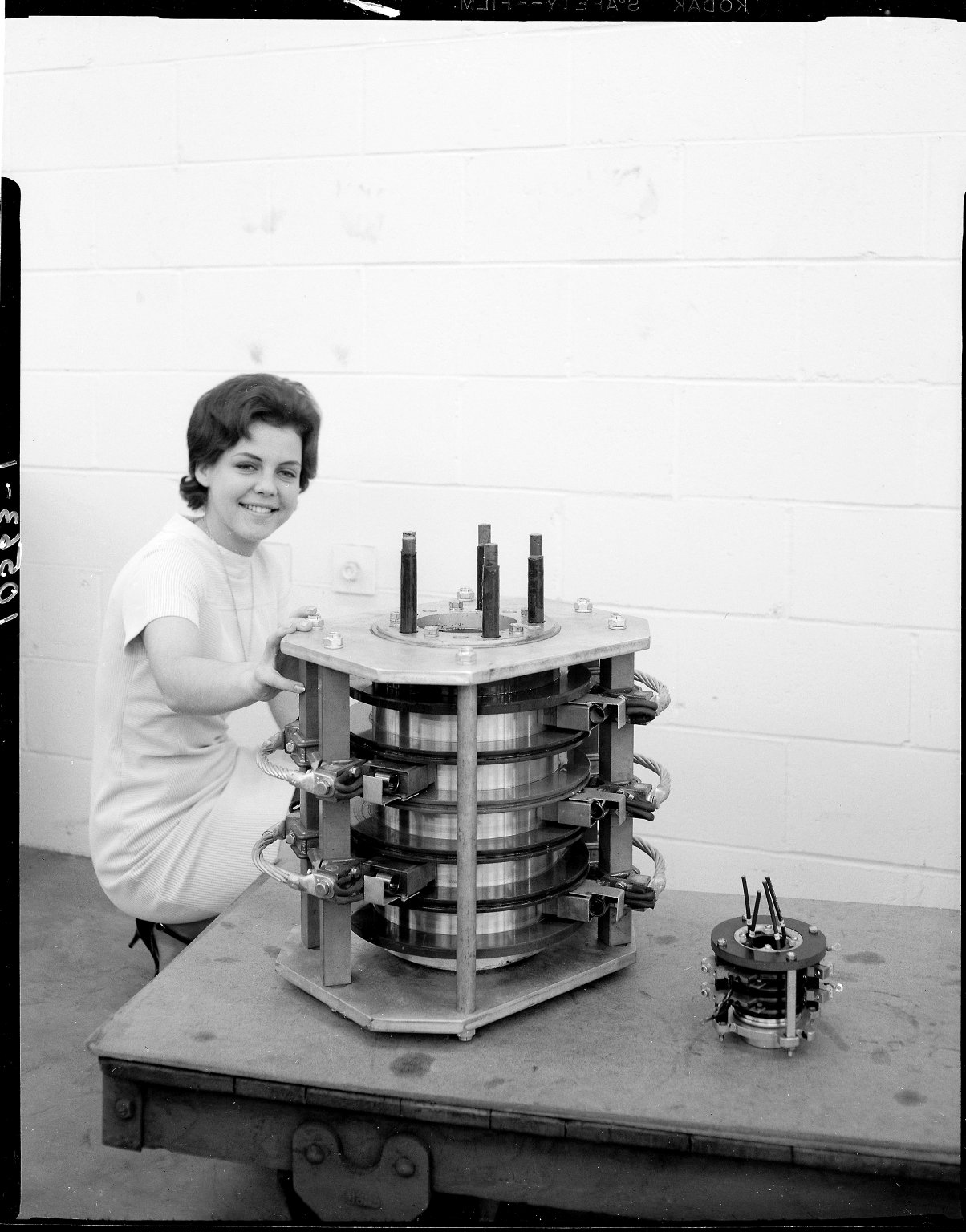 Aero-Motive Manufacturing Company, woman with industrial collector ring