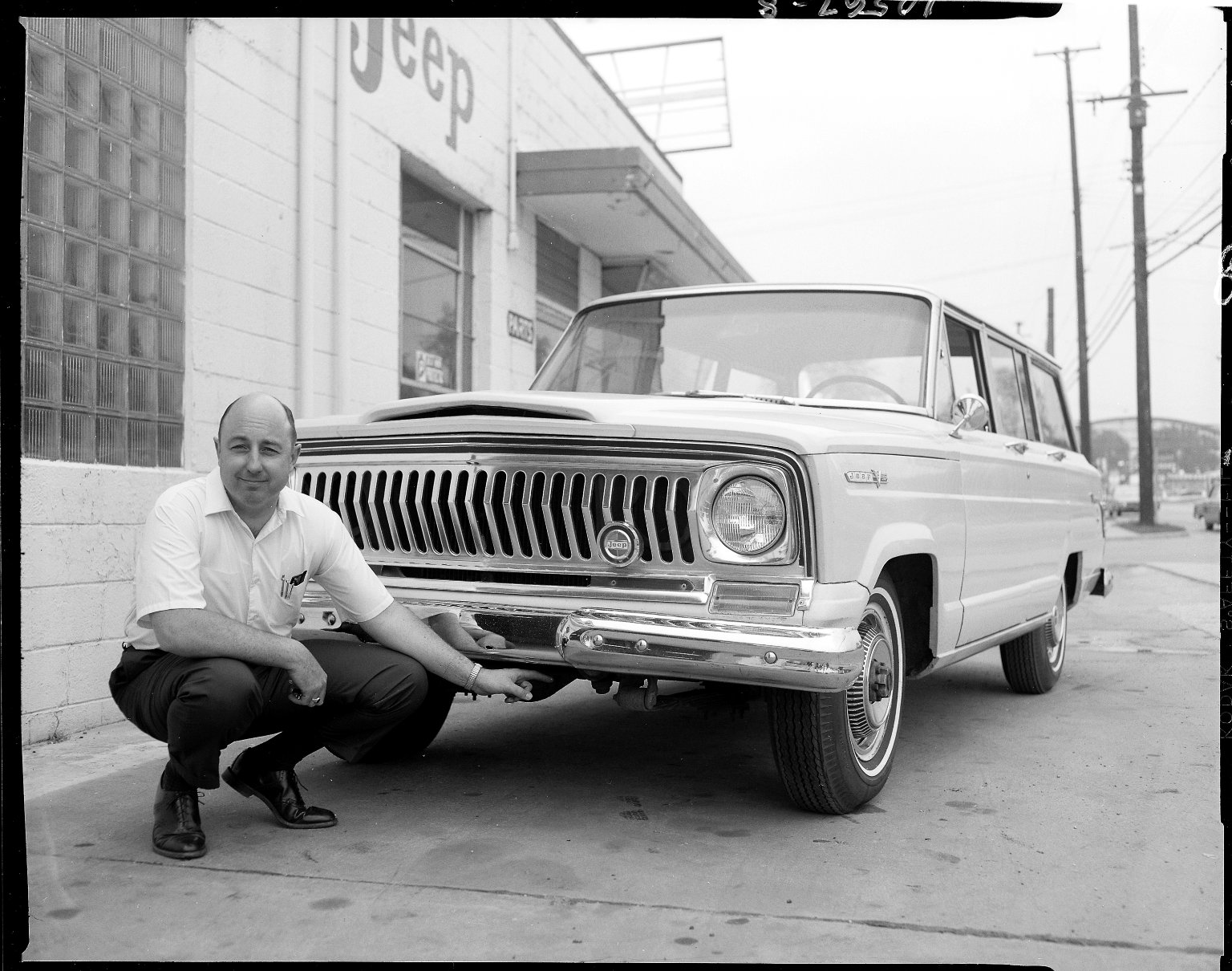 Man with Jeep Wagoneer