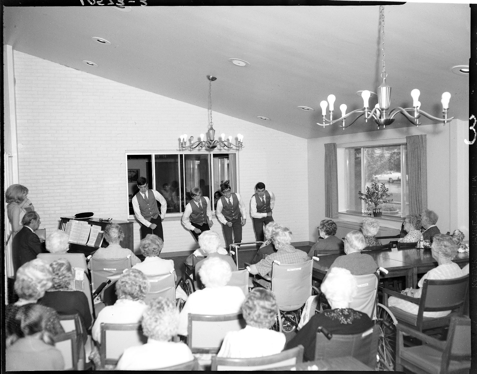 Harold and Grace Upjohn Community Nursing Home, four young men dancing for residents