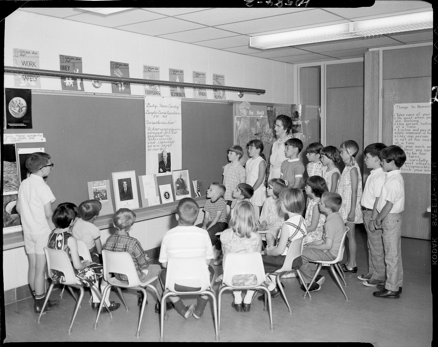 Winchell School, Mrs. Mildred Borton's classroom looking at pictures of President Eisenhower and Vice President Nixon