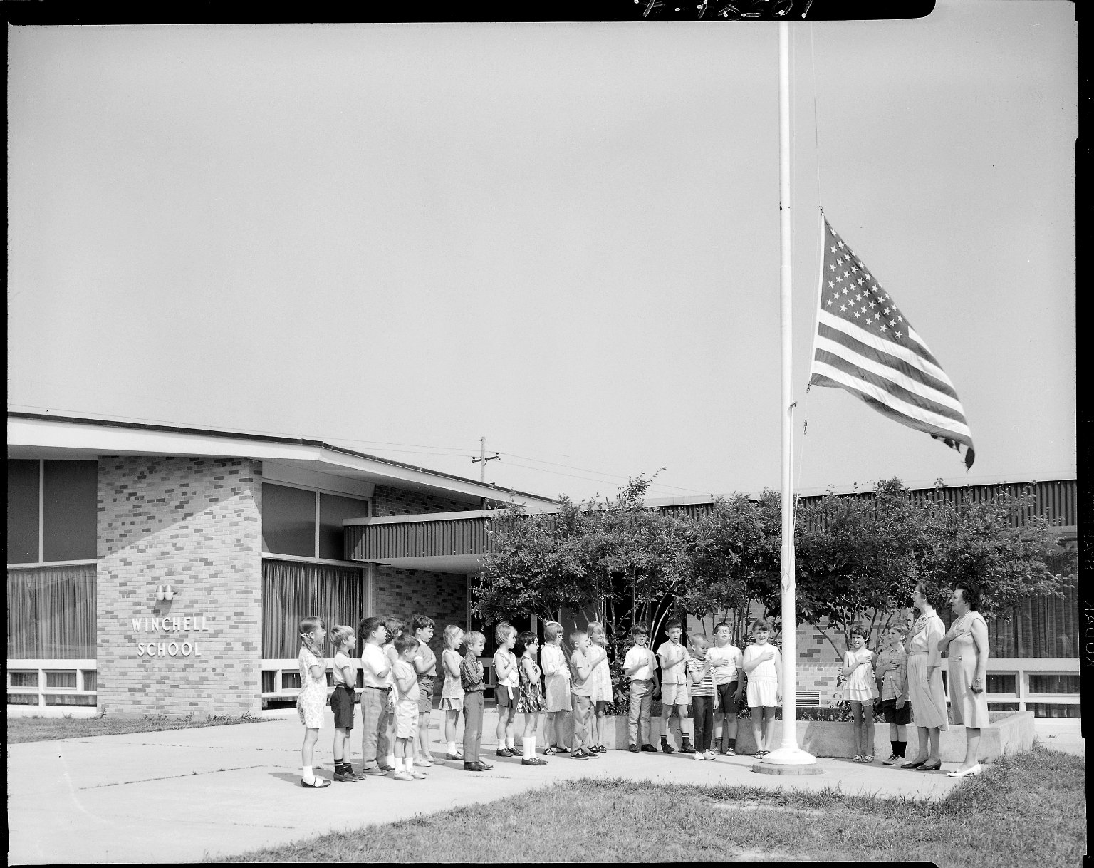 Winchell School, Mrs. Mildred Borton's classroom with U.S. flag in front of school