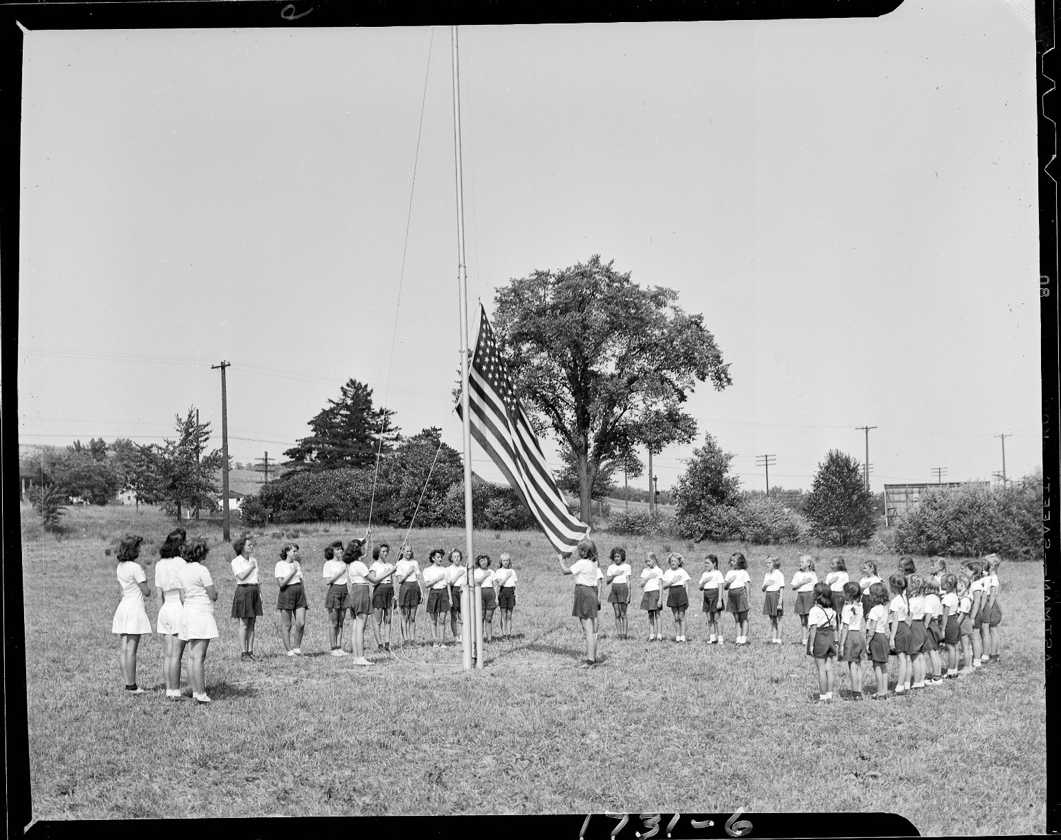 Young girls at flag raising