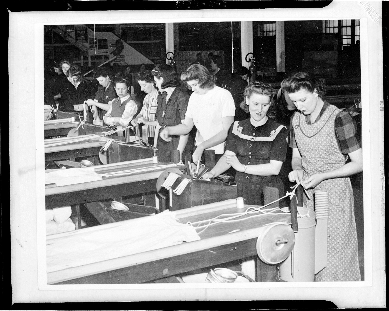 Kalamazoo Stove Company, workers preparing parachutes for loading into flares