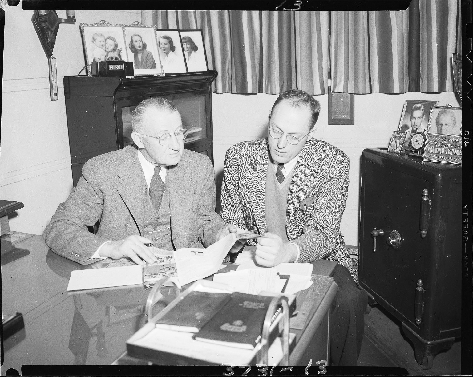 John P. Koester Company, men working together in an office