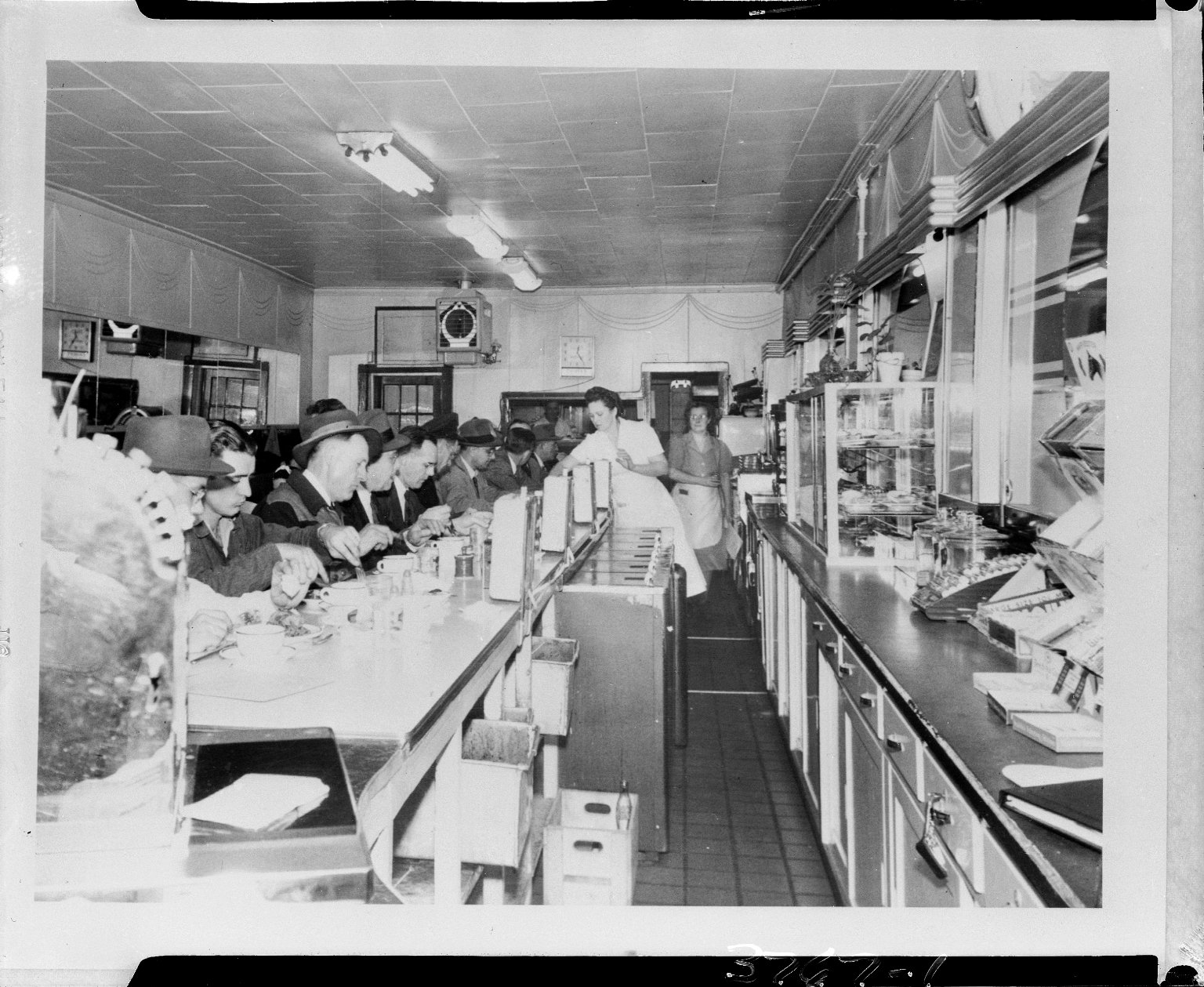 General Gas Light Company, diners and wait staff at a lunch counter