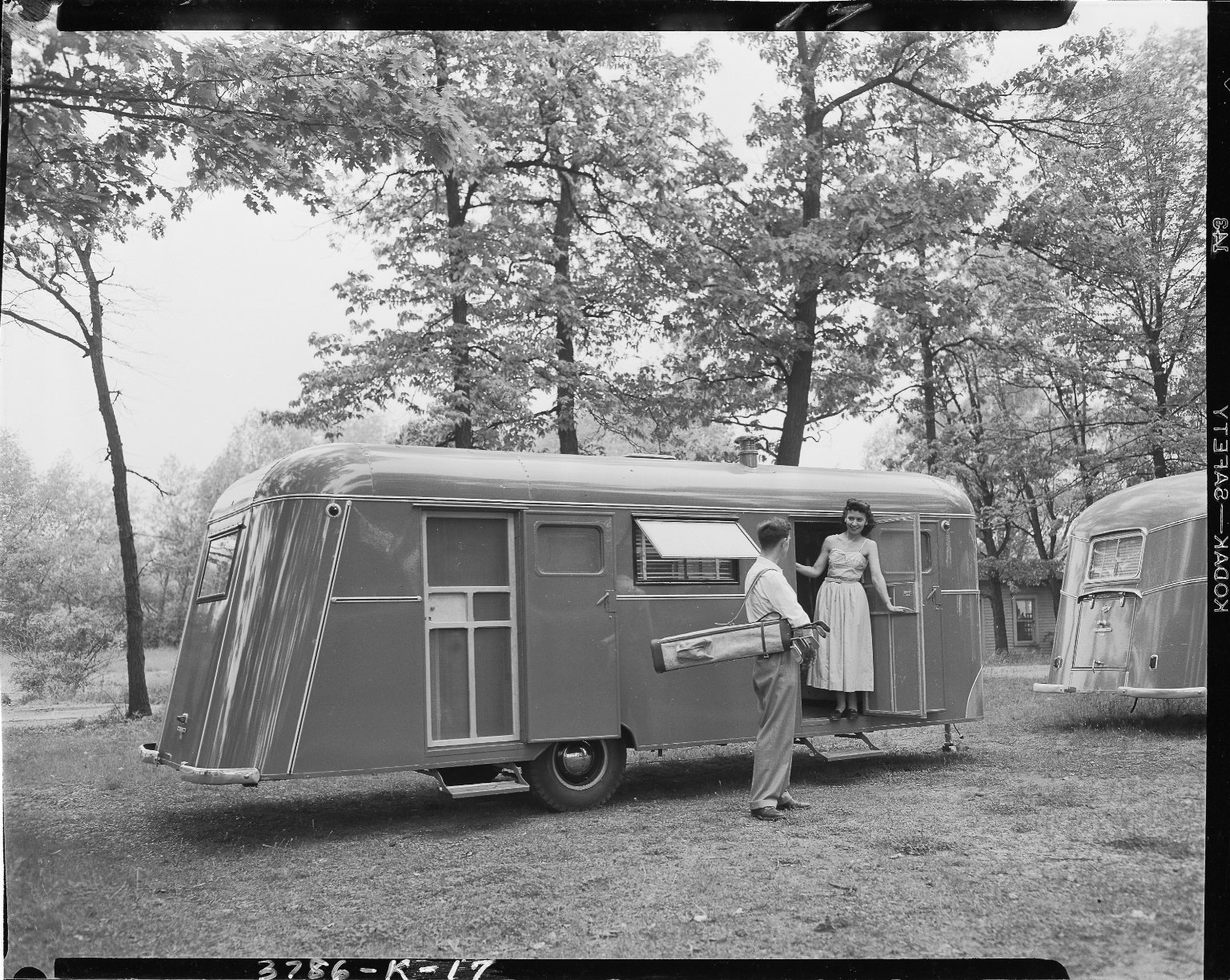 Kozy Coach Company, trailer exterior, with man and woman