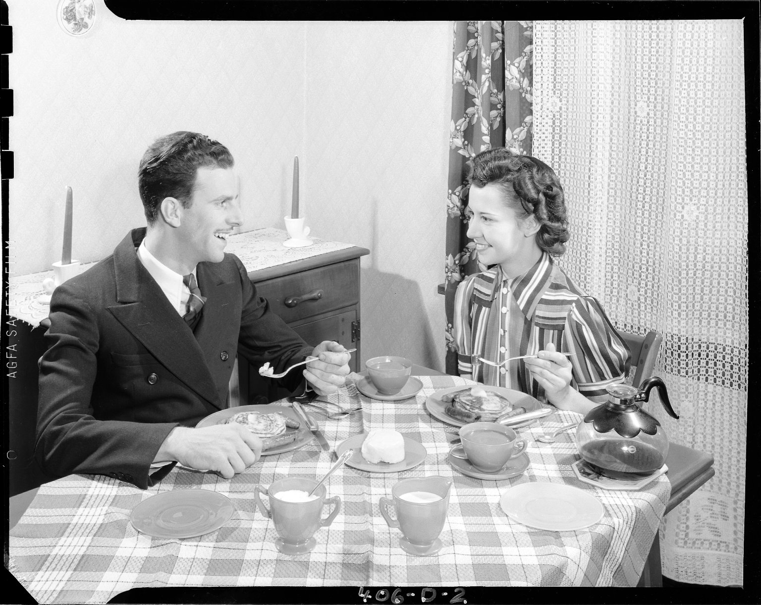 Sutherland Paper Company, man and woman at breakfast table