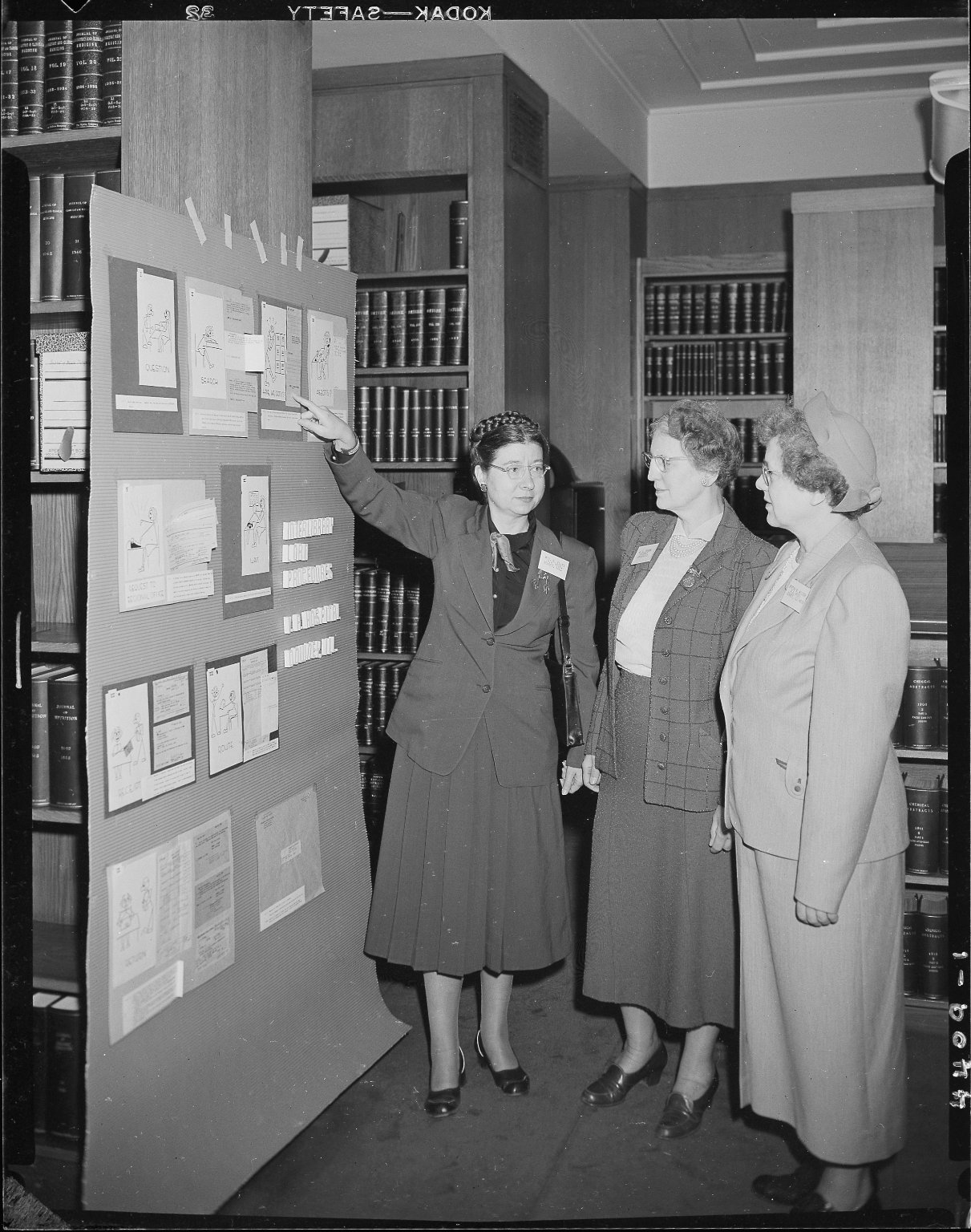 Upjohn Company, librarians viewing display board