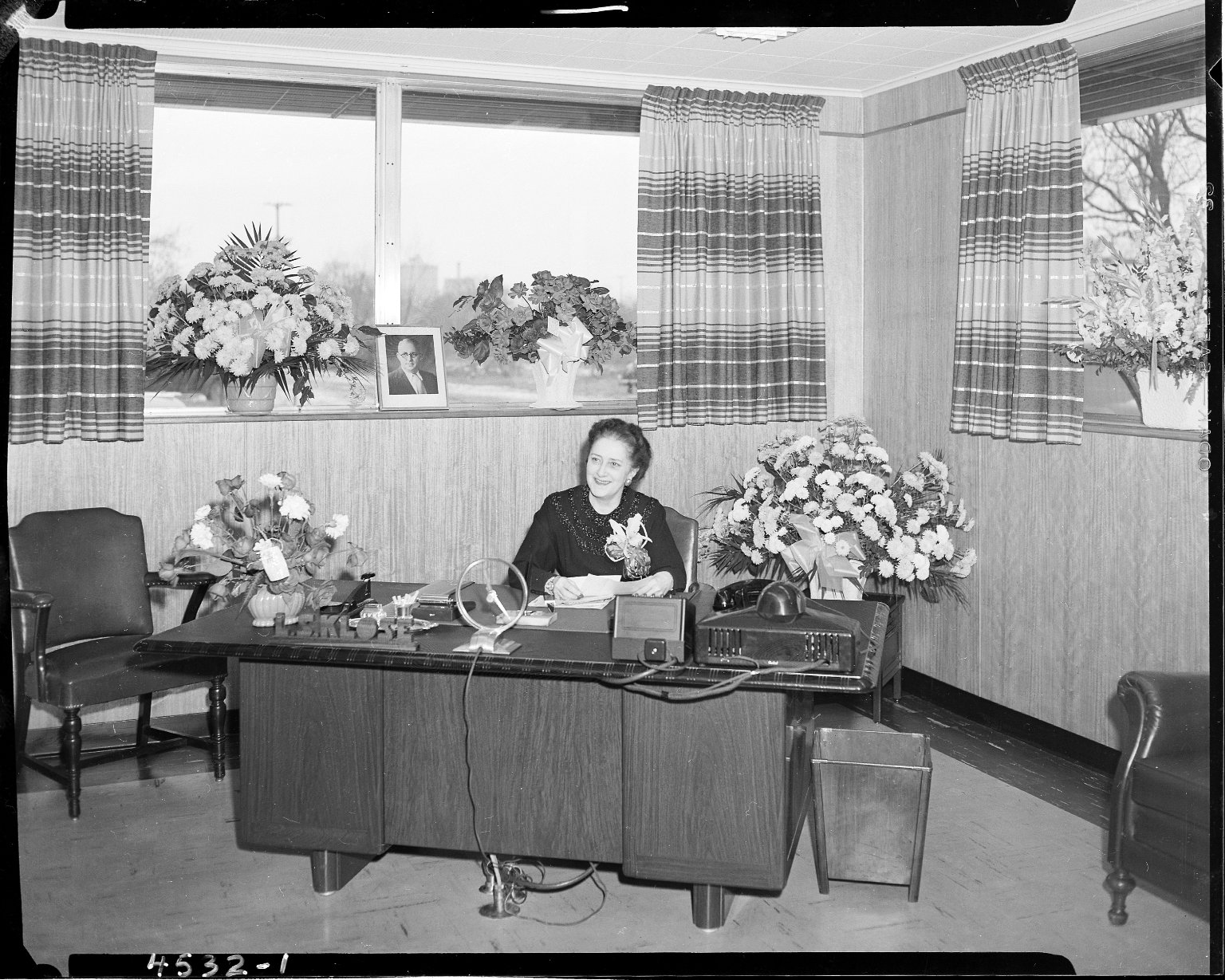 Klose Electric Company, Lucille Klose at her desk, Kalamazoo, MI