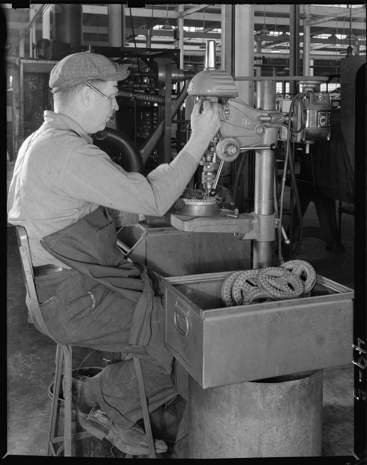 Atlas Press Company, employee of Humphrey Company operating drill press, profile view