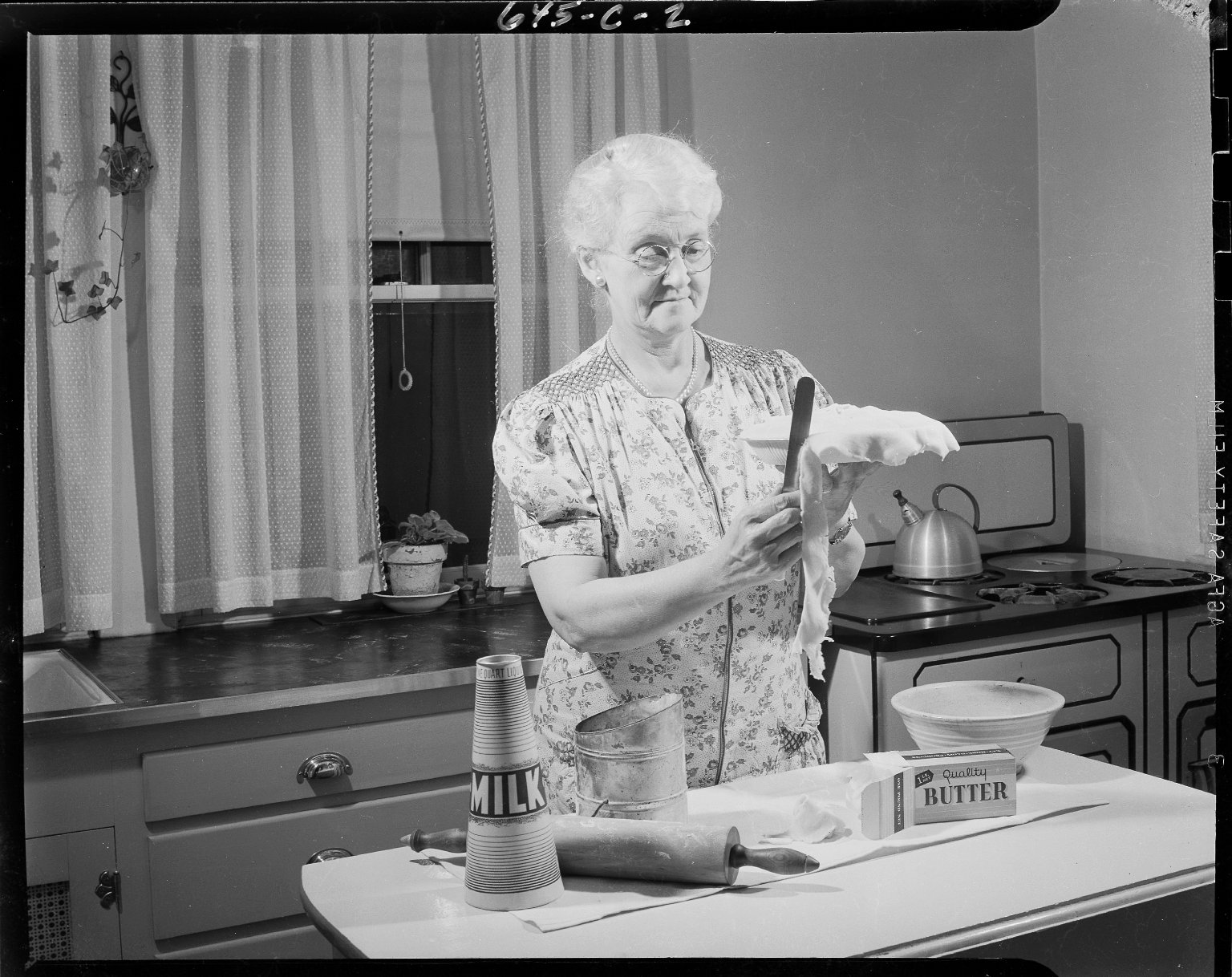 Woman trimming pie