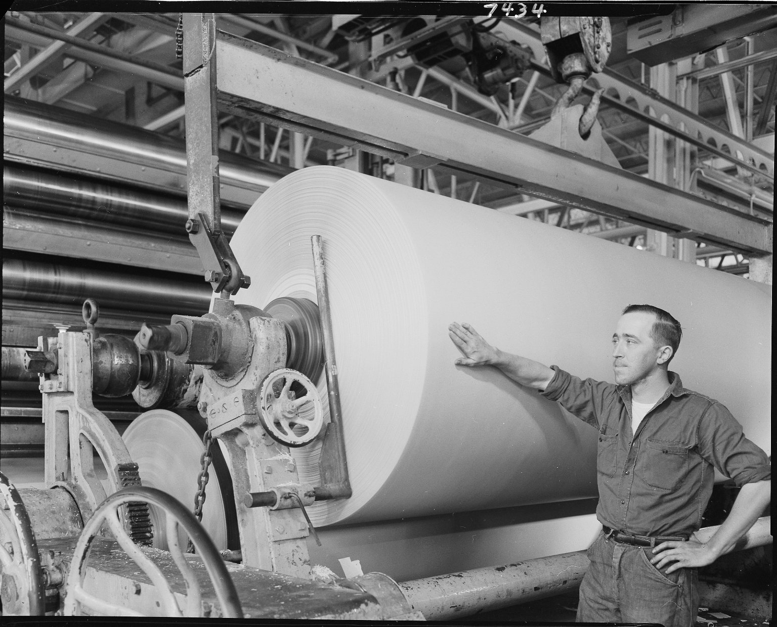 Michigan Bakeries, man working at paper board machine