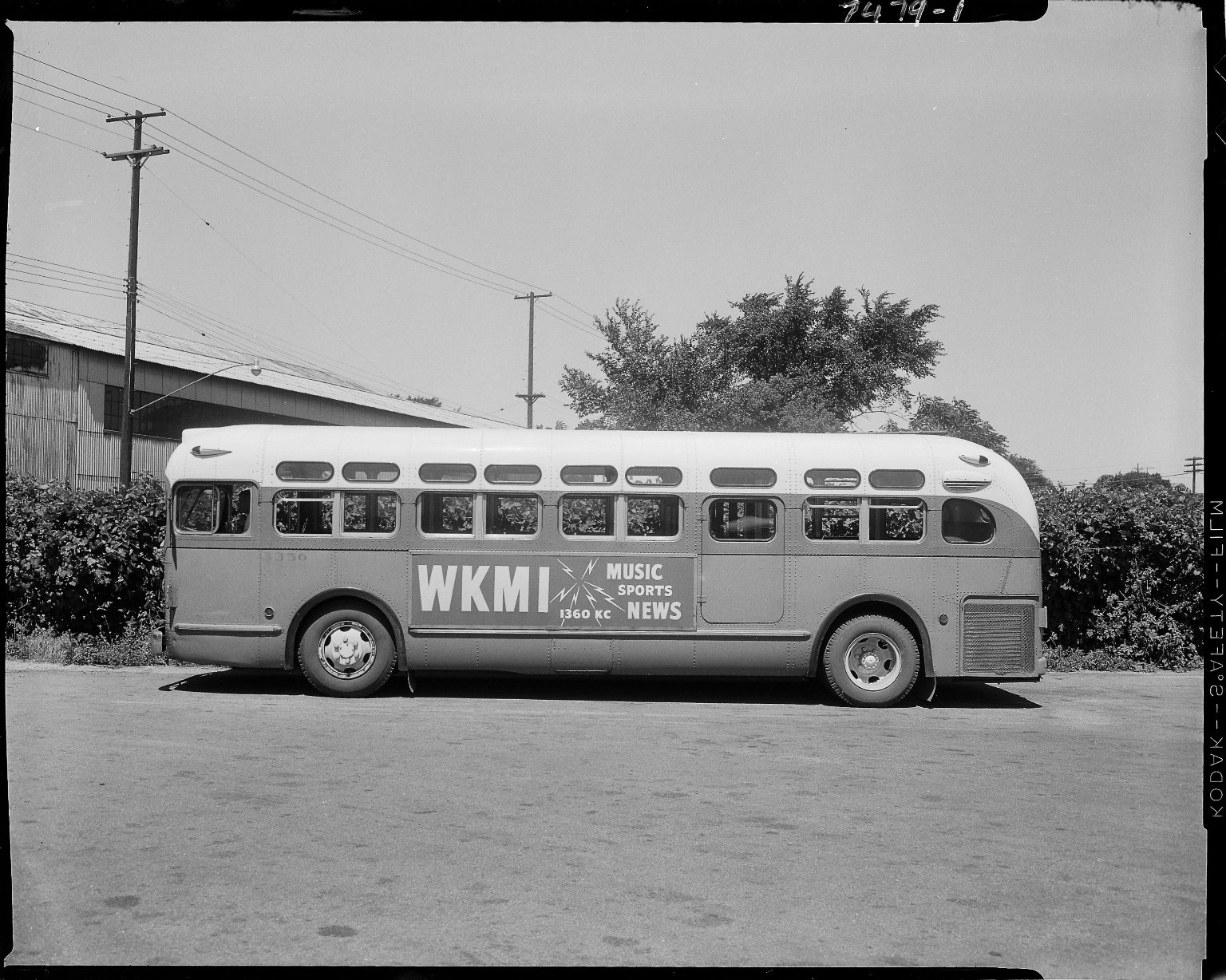 Bus with advertising sign, WKMI Radio
