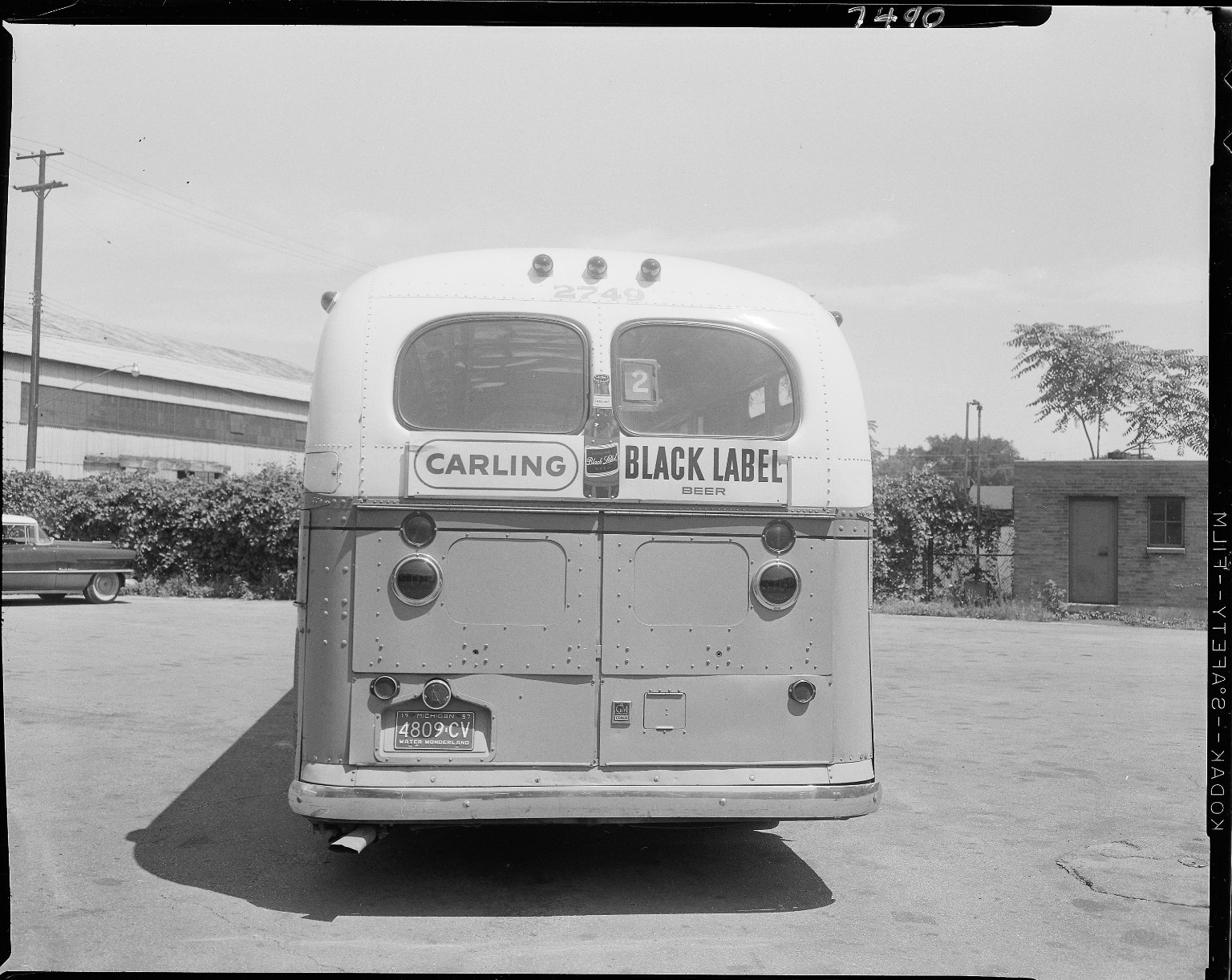 Bus with advertising sign, Carling Black Label Beer