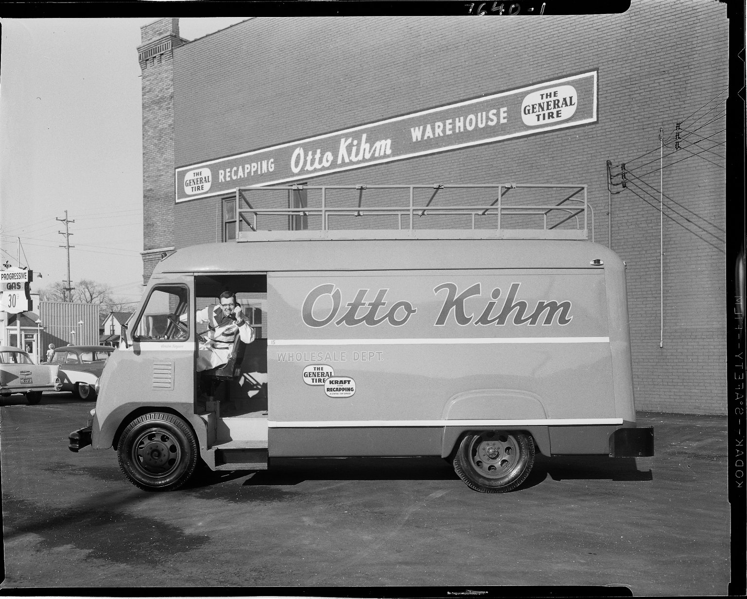 Otto Kihm Tire Company, delivery van, exterior, with driver