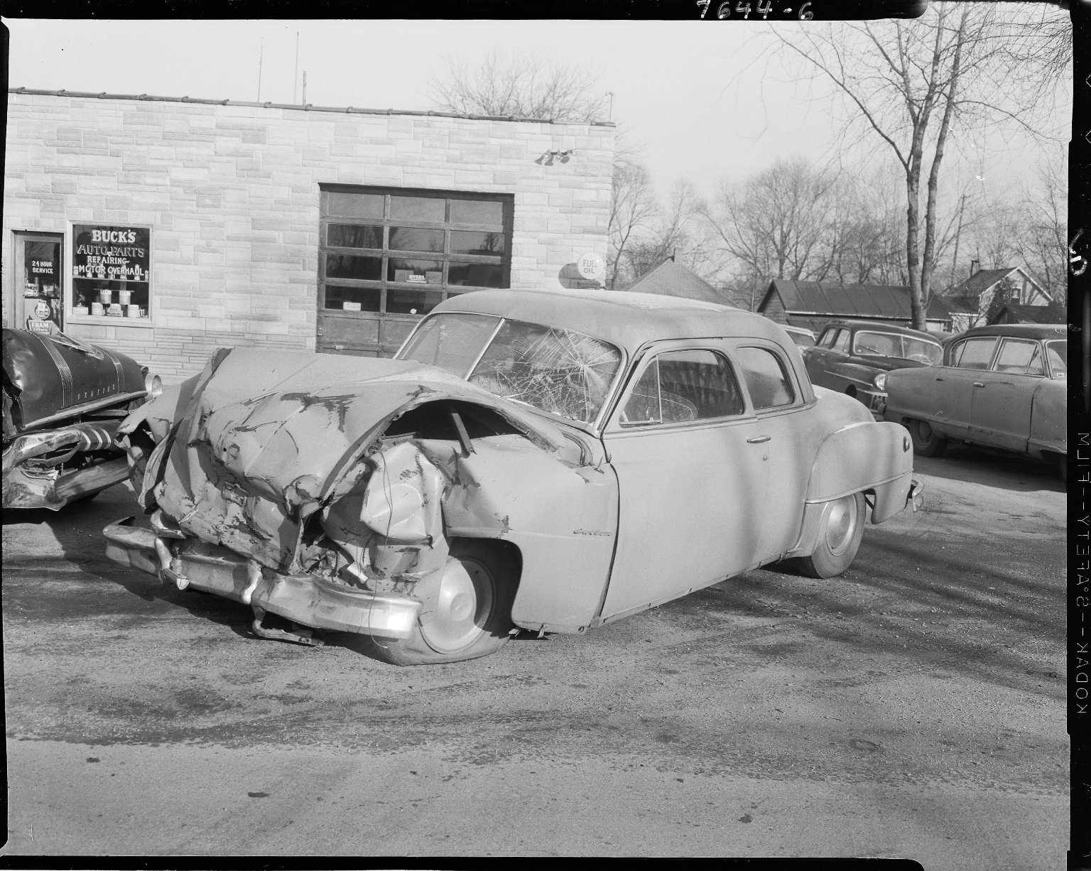 Oldsmobile Futuramic car, after accident, at Buck's Auto Parts