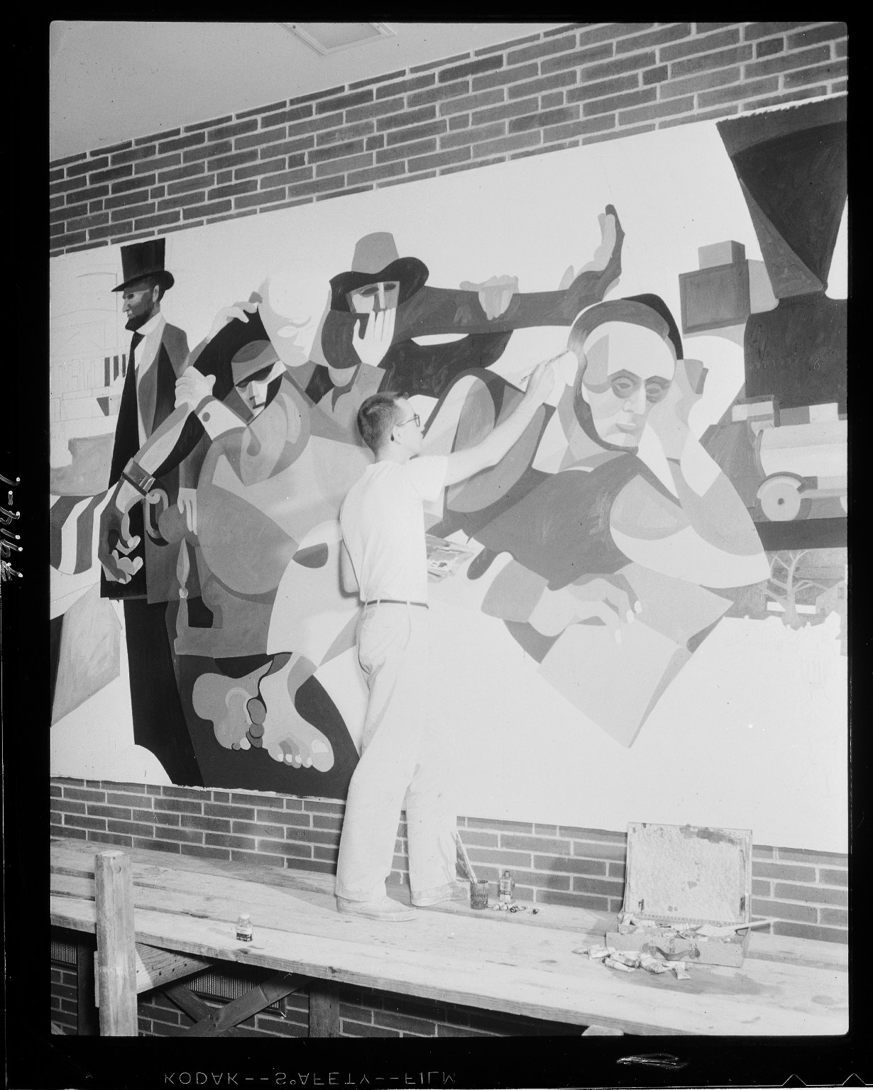 Western Michigan University, Dwight B. Waldo Library, interior, mural being painted by Timothy Lewis