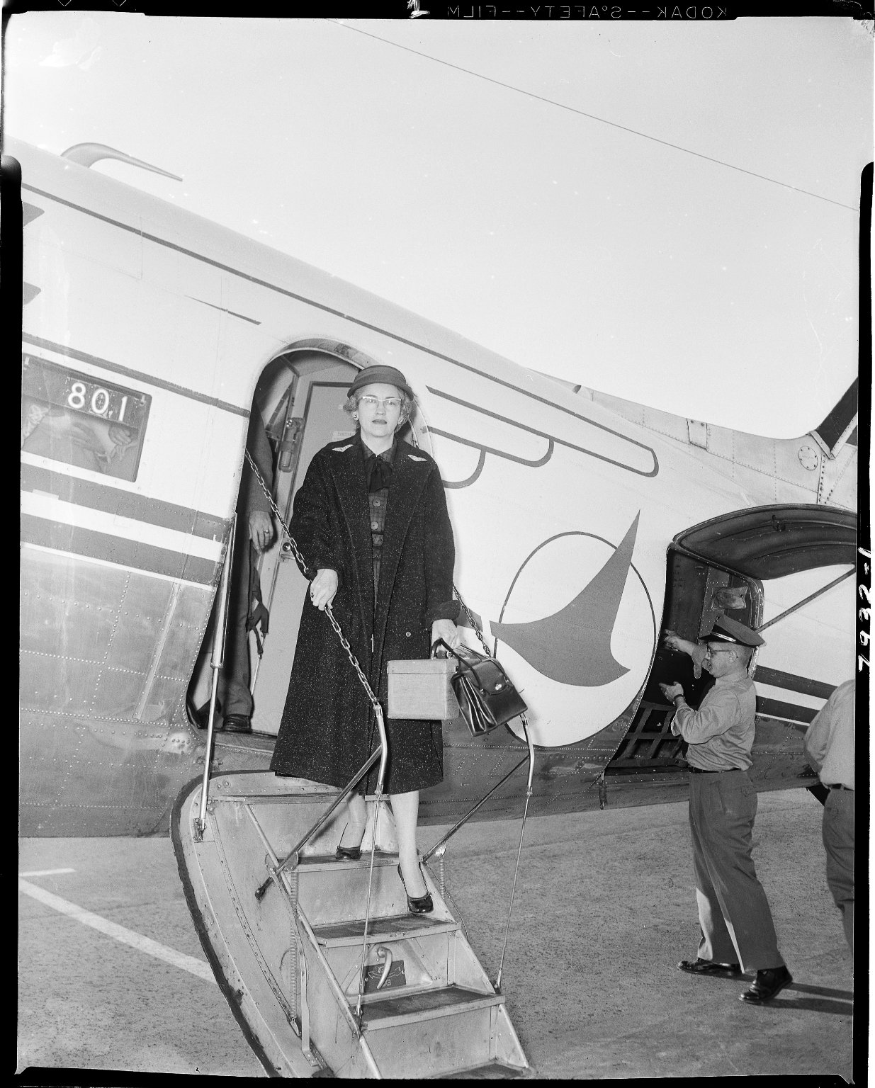 Gussie Rose Case exiting an airplane