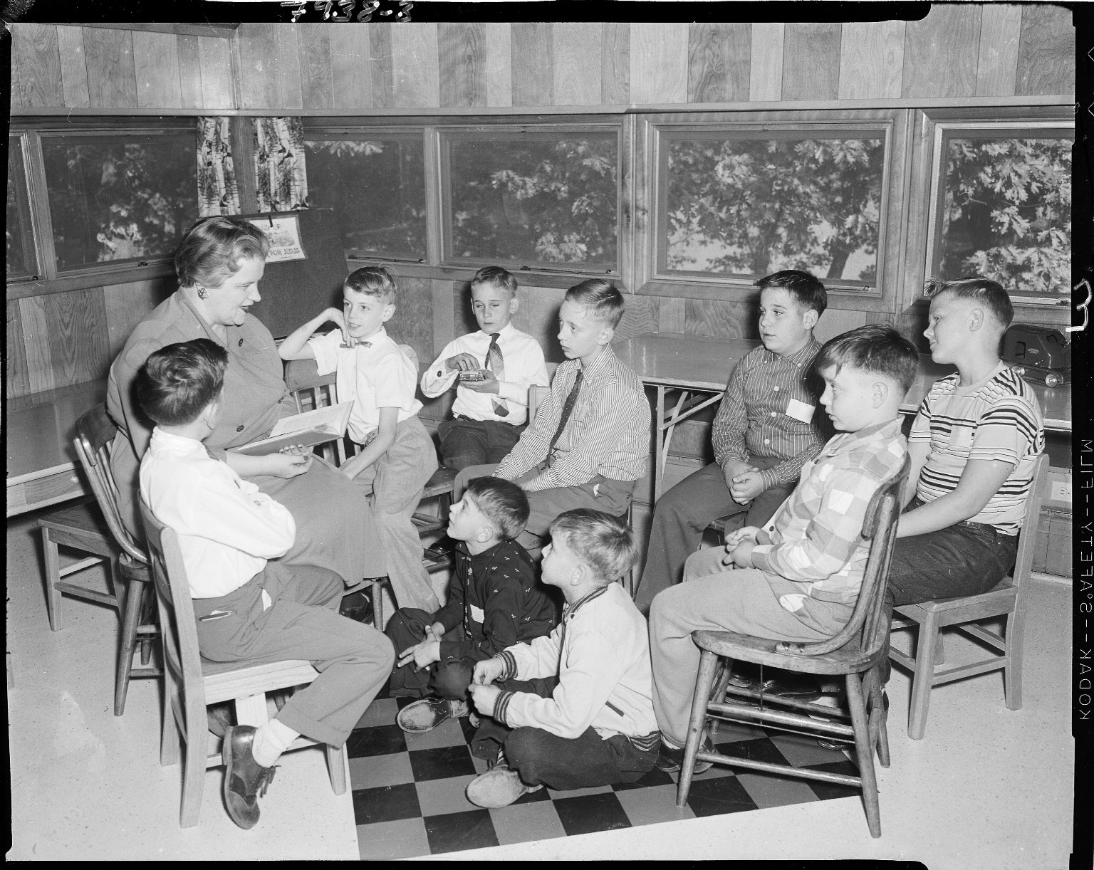 Lake Farm Boys Home, Kalamazoo, interior, woman reading to boys in a classroom