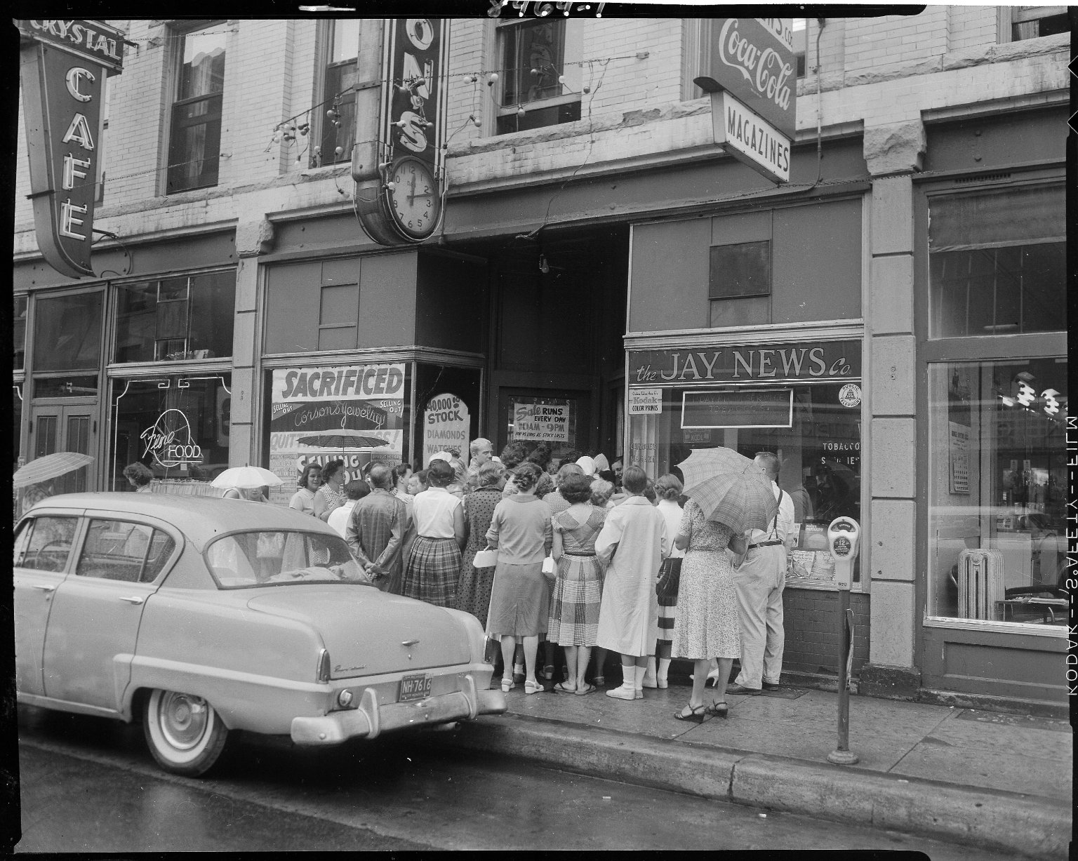Corson's Jewelry store, exterior, with crowd in front for selling out sale
