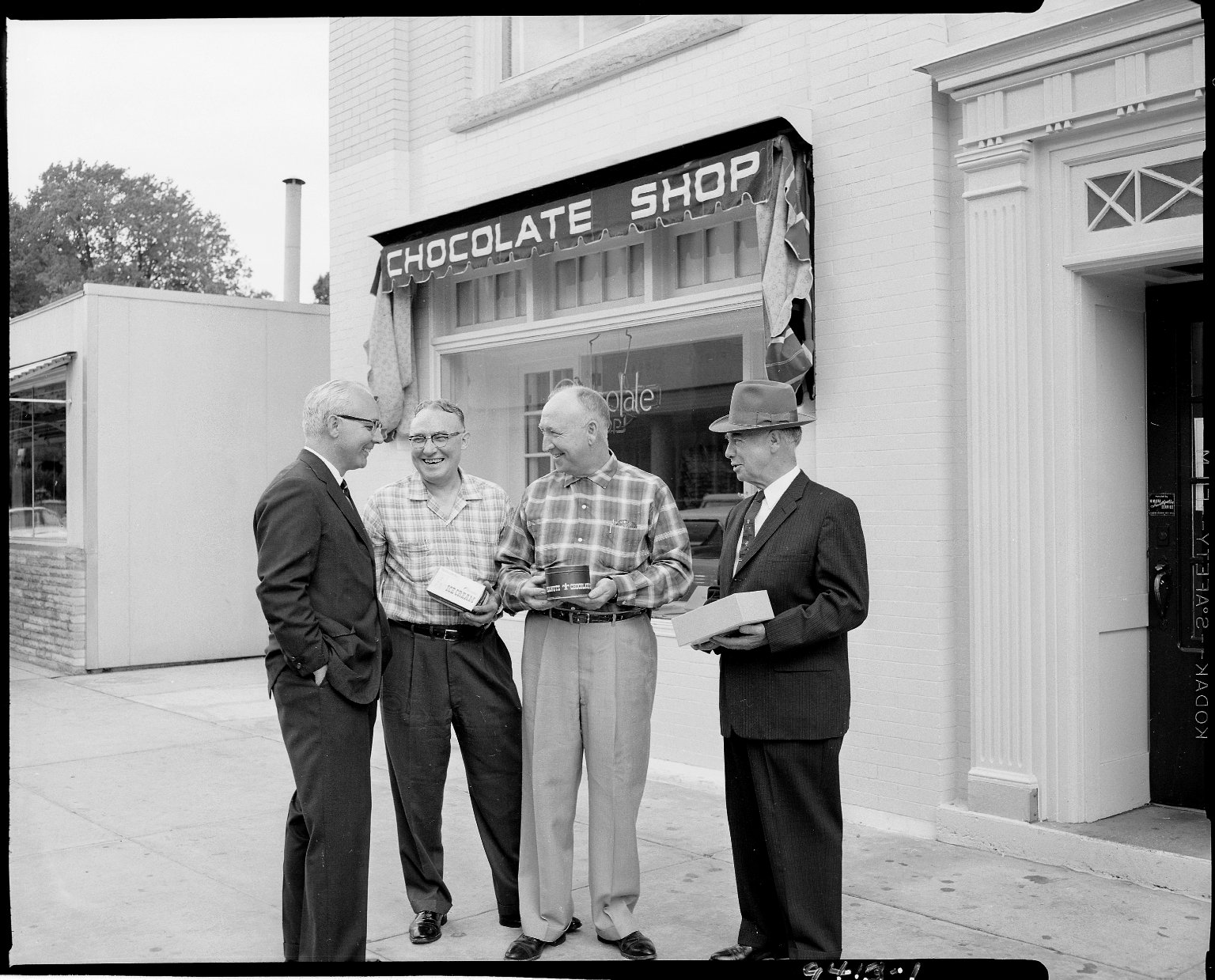 Chocolate Shop, exterior, with four men standing in front