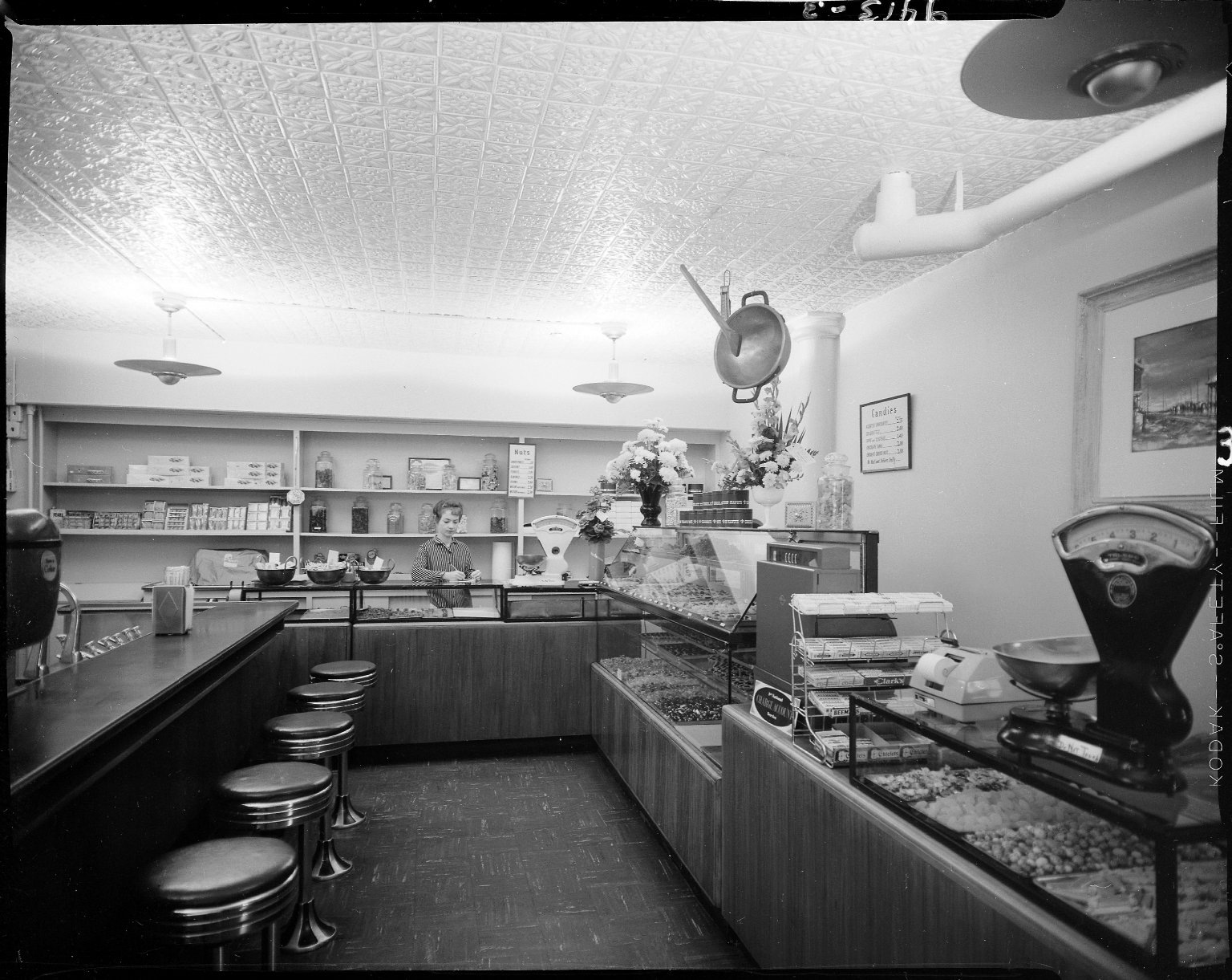 Chocolate Shop, interior, with saleswoman behind counter