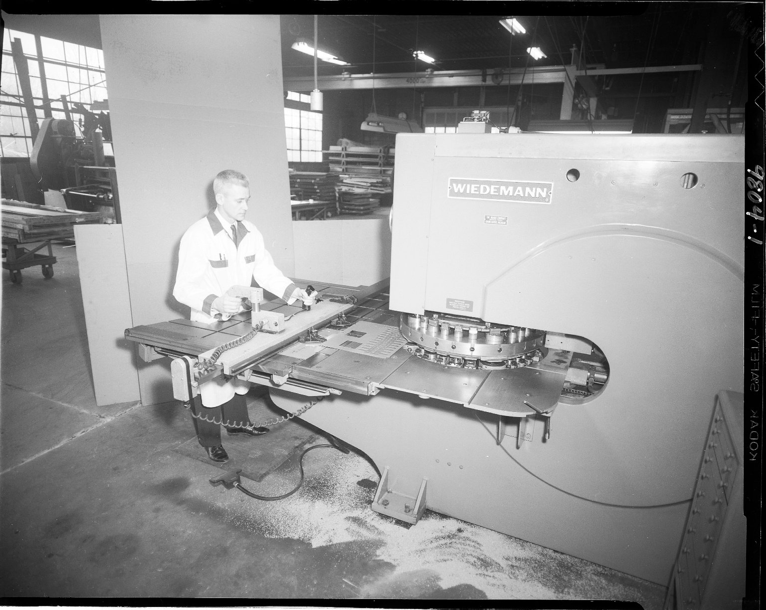 Unifab Corporation, worker at Wiedemann sheet metal machine