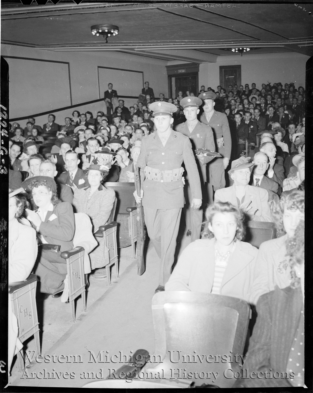 Shakespeare Company, three soldiers marching down isle at the Army Navy E Award Ceremony