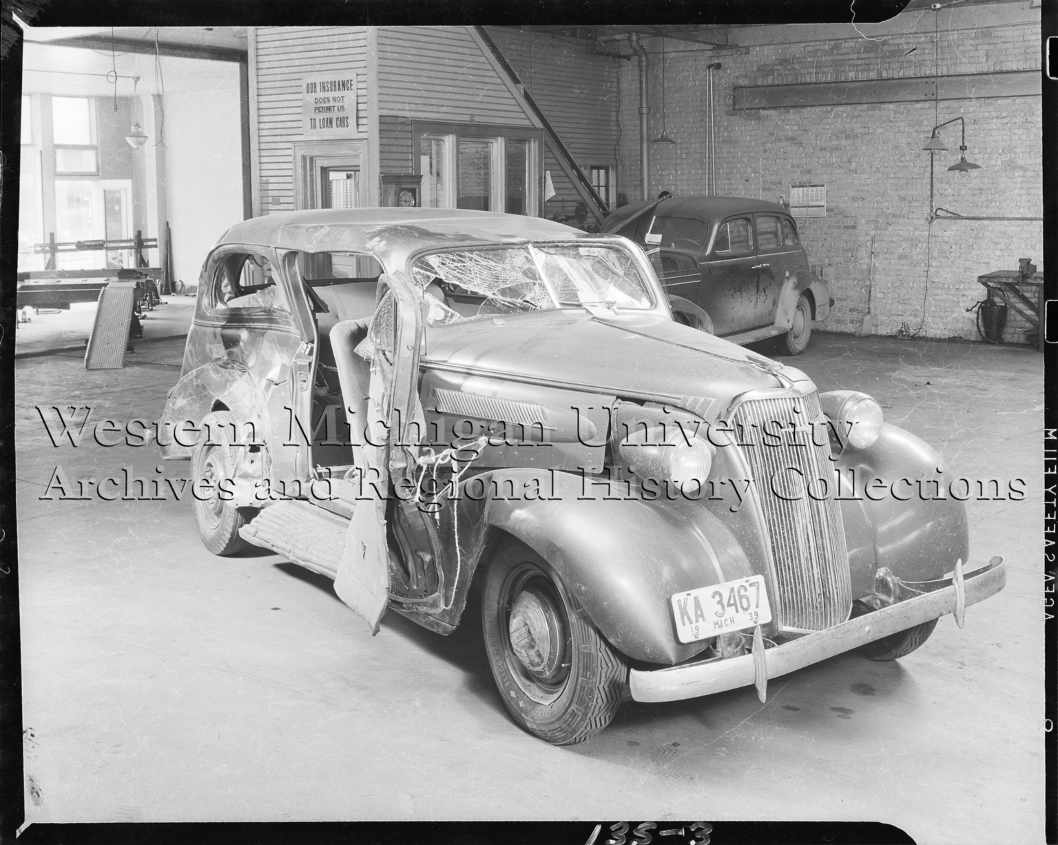 1937 Chevrolet car, after accident, at service center
