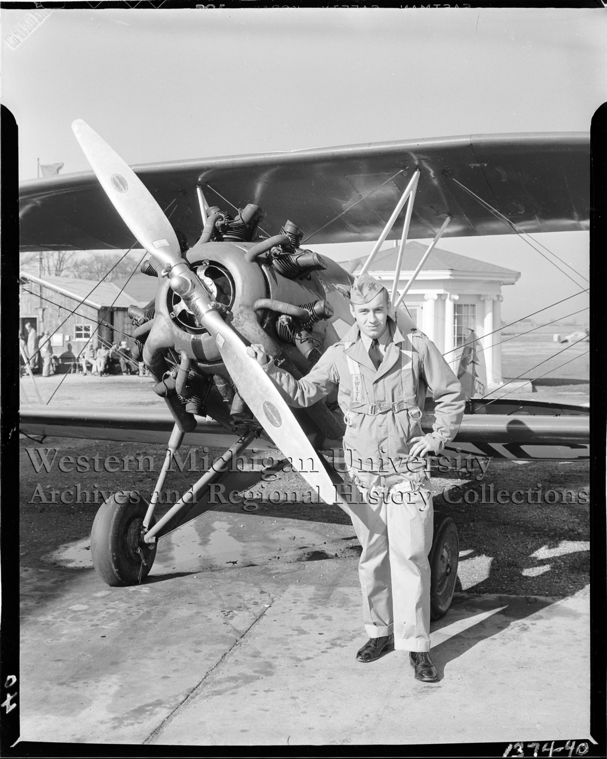 Western Michigan Flying Service, portrait of cadet with plane