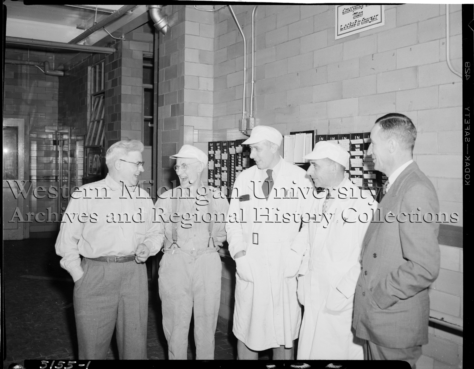 Peter Eckrich & Sons Company employees chatting in front of the time clock