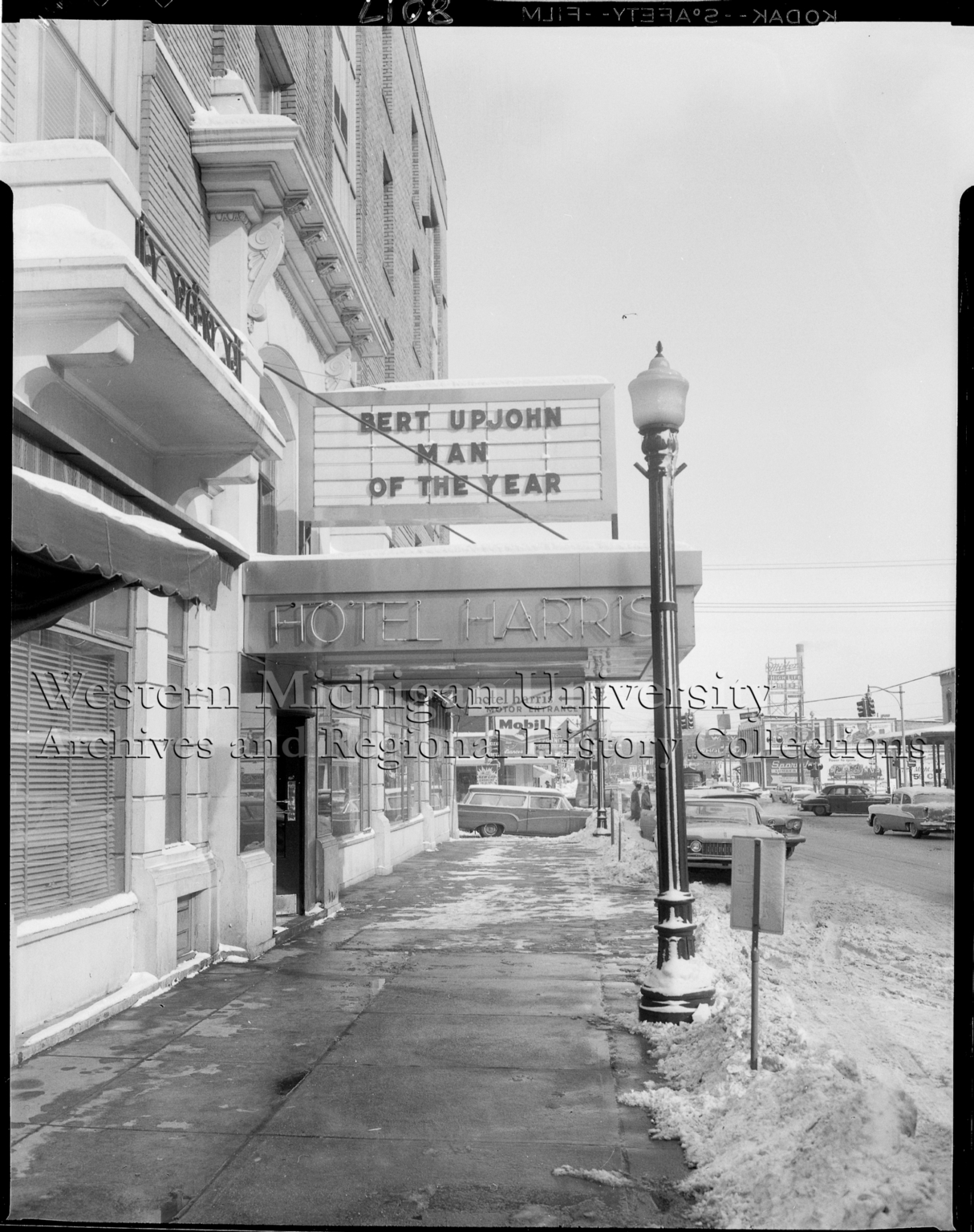 Marquee sign at the Hotel Harris featuring Bert Upjohn Man of the Year